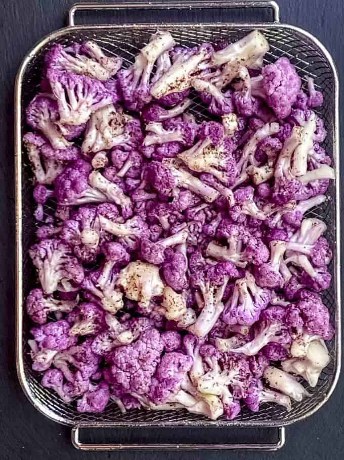 Cauliflower Florets in a pan ready to be roasted