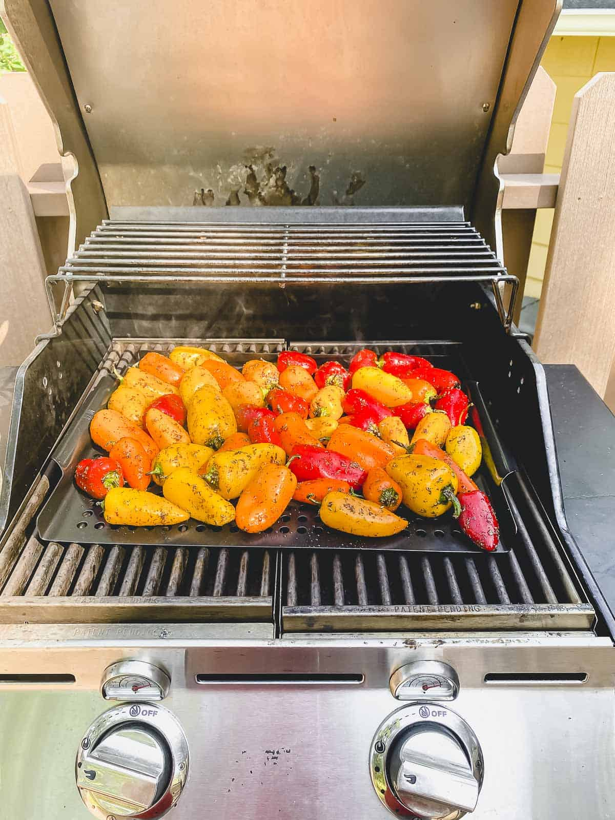 Sweet peppers on a grill pan on the grill