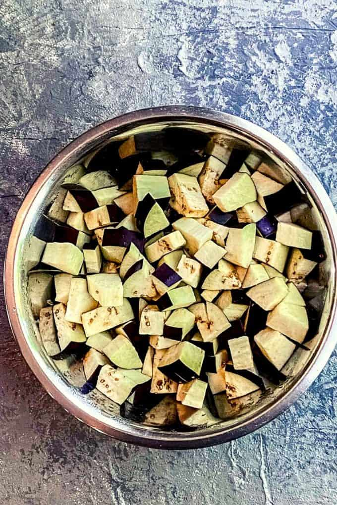 Overhead view of a bowl of cubed eggplant