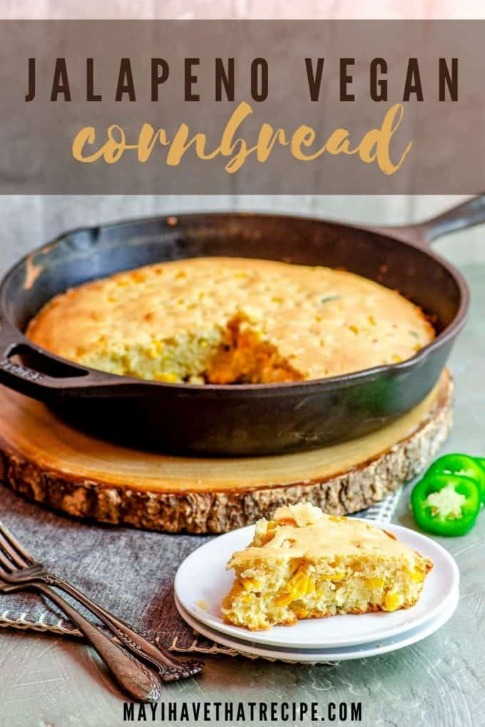 A slice of cornbread on a plate with a skillet with cornbread in the background