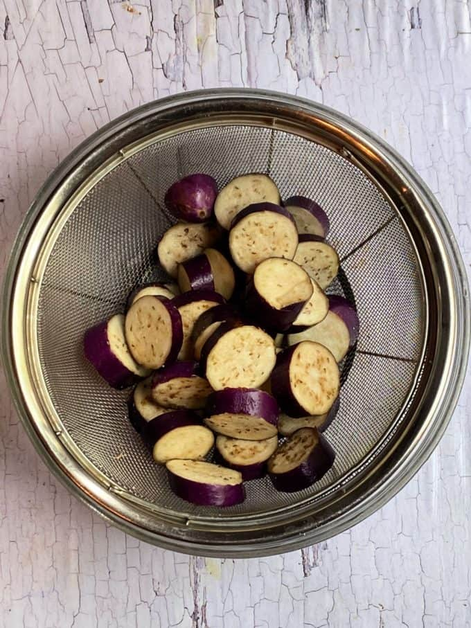 Eggplant slices in a colander