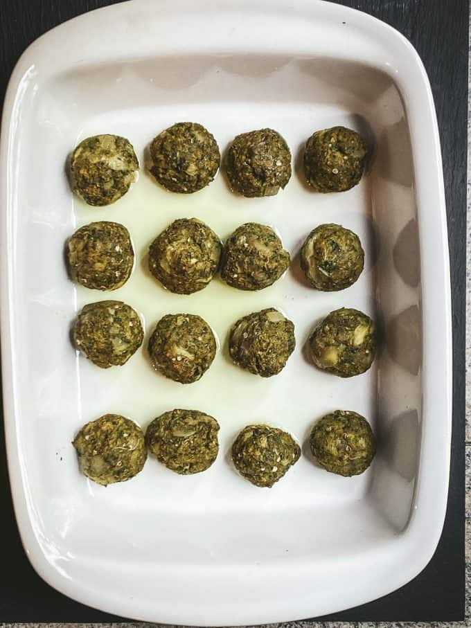 baked eggplant meatballs in a baking dish