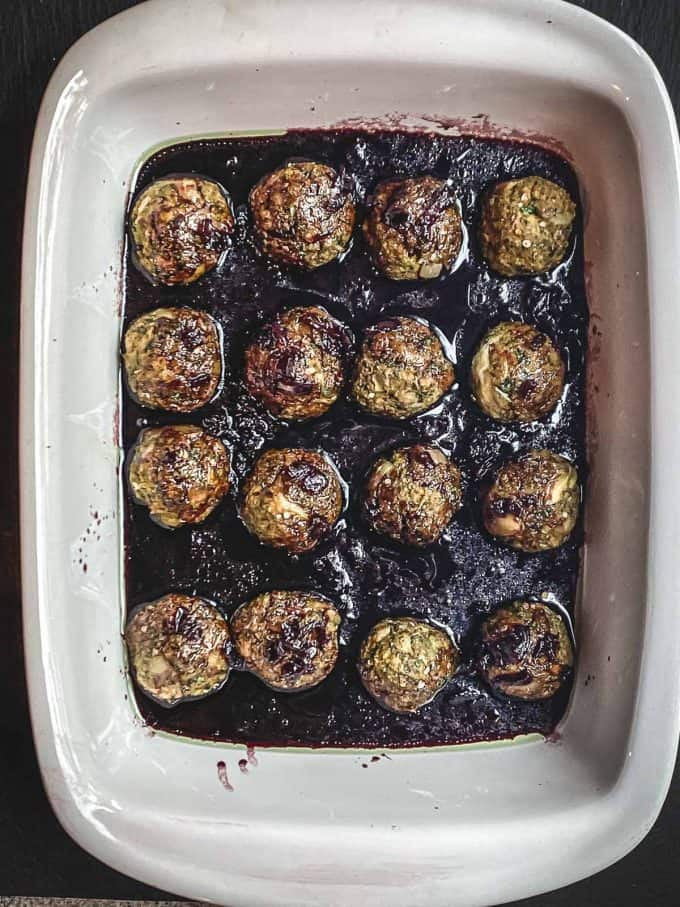 eggplant meatballs with pomegranate molasses sauce in a baking dish