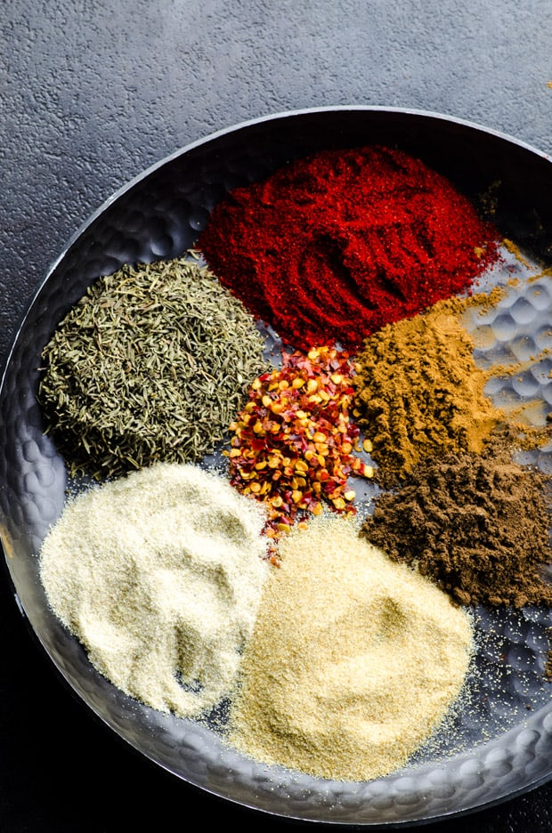 Spices for Jamaican Jerk on a round metal plate